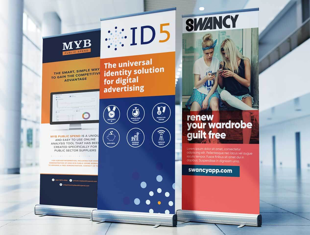 Image showing three different designs on three pull up banners located in an office space